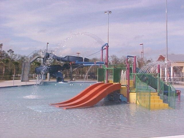 A large slide in a pool.